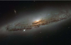 NGC 4845's Glowing Center Holds Giant Black Hole