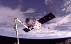 Dragon capsule docks with ISS