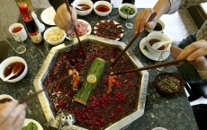 Chinese People Enjoy Hot Pot At A Restaurant