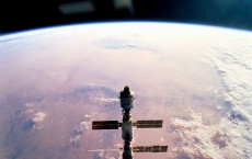 Silhouetted Over Earth The International Space Station