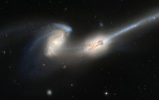 Pair Of Galaxies Engaged In A Celestial Dance