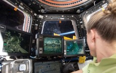 robotics workstation in the International Space Station's Cupola, NASA astronaut Karen Nyberg