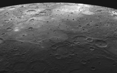 Lava-flooded craters and large expanses of smooth volcanic plains on Mercury's surface. NASA