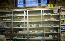 Near empty cigarette shelves are seen at a CVS store in New York February 4, 2014.