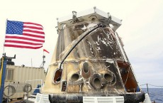 The current Dragon spacecraft is retrieved after it lands in the ocean.